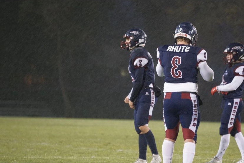 Colin Stuhr (12) gets ready for the next play on the field.
